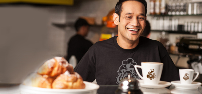 Image of happy cafe employee.